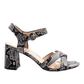 Sandali in pelle di serpente su montante in pelle scamosciata X-116 nero