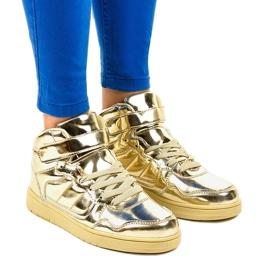 Sneakers laccate oro XW7082 giallo